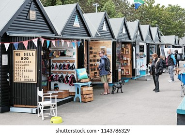 WHITSTABLE, ENGLAND - JUNE 17, 2018: Tourists in Whitstable South Quay market, Whitstable, UK. Whitstable is famous for its Native Oysters which are collected since Roman times.