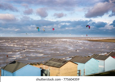 WHITSTABLE, ENGLAND - NOV 12 2017.  Kite surfers take advantage of the big shingle beach and a windy day in one of north Kent's most popular kitesurfing locations.