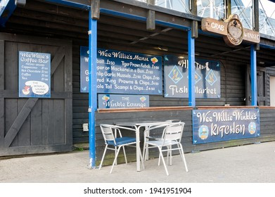 WHITSTABLE, KENT, UK - APRIL 30, 2011:  Exterior view of Crab and Winkle Restaurant on the quay at Whitastable Harbour