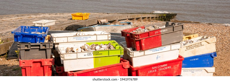 WHITSTABLE, KENT, UK - APRIL 30, 2011:  Panorama view of colourful Boxes full of Oyster shells on the beach at a oyster shell recycling point - a project to re-stablish oyster beds in the area