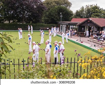 Whitstable, UK, 20th August 2015. Whitstable bowling club hosts a competition with Gravesend Men's Veterans.  Viewed from the free entry public gardens of Whitstable Castle.