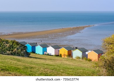 Whitstable, UK - OCT 15 2017.  A warm day in Ocotber and tourists and locals enjoy the locally called 'Whitstable Street'  a spit of land only accessible at low tide and the colourful beach huts