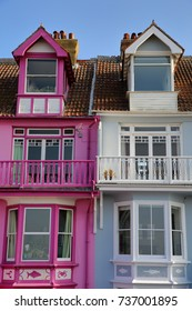 WHITSTABLE, UK - OCTOBER 15, 2017: Colorful houses with wooden balconies overlooking the sea