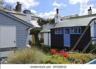 WHITSTABLE, UK-JULY 22: A row of traditional English fishermen's cottages and weather boarded buildings. Whitstable has been named a property hot spot in 2017.July 22, 2017 in Whitstable, Kent UK.