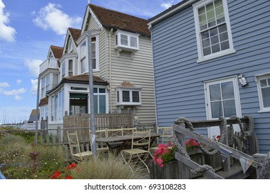 WHITSTABLE, UK-JULY 22: A row of traditional weather boarded houses along Whitstable sea front. Whitstable has been named as a property hot spot in 2017.. July 22, 2017 Whitstable, Kent,  UK.