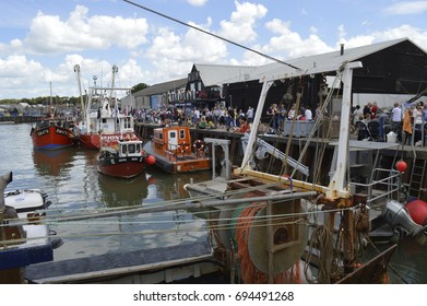 WHITSTABLE, UK-JULY 22:Visitors flock to the harbour to sample oysters in the annual Whitstable Oyster Festival. July 22, 2017 in Whitstable kent UK.