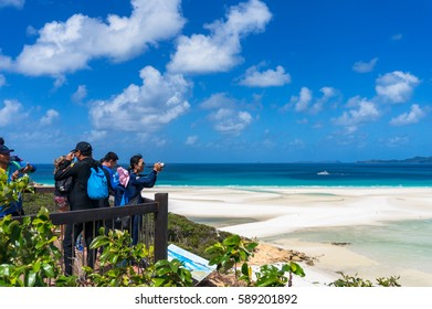 Whitsunday, Australia - February 5, 2017: People on Hill Inlet lookout observation platform with view of Hill Inlet estuary and Whitehaven Beach. Whitsundays Queensland, Australia