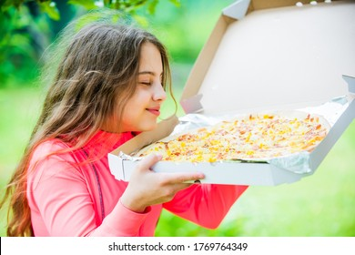 who cares about diet. her favorite food. junk food concept. happy child hold big pizza. meal delivery in time. hungry kid eating pizza. looking tasty and perfect. feel real hunger.