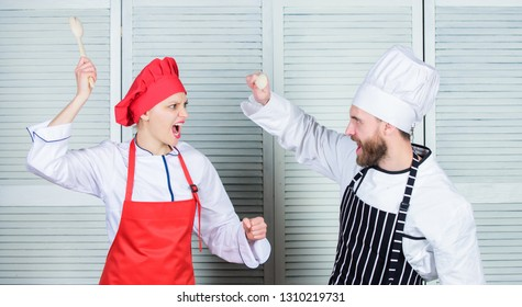 Who cook better. Culinary battle concept. Woman and bearded man culinary show competitors. Ultimate cooking challenge. Culinary battle of two chefs. Kitchen rules. Couple compete in culinary arts.