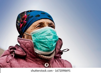WHO and coronavirus. Coronavirus in Europe. Old woman in medical mask closeup. Masked man due to outbreak of coronavirus.SARS-CoV-2.Coronavirus and masks.