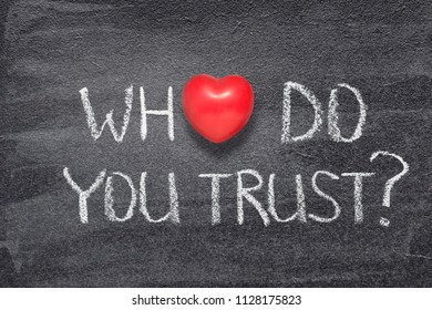 who do you trust question handwritten on chalkboard with red heart symbol instead of O