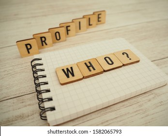 Who with a profile in a wooden block? The word