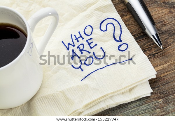 who are question on a napkin with a cup of coffee