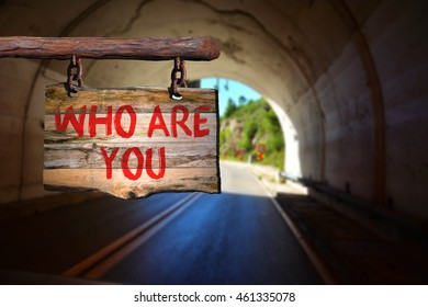Who are you motivational phrase sign on old wood with blurred background