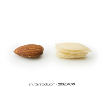 Whole almond and sliced almonds side by side, isolated on white.