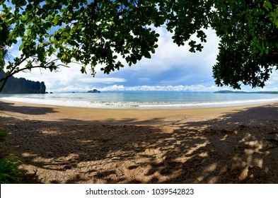 The whole Ao Nang bay in the morning seen from the shady beach, Krabi province, Thailand