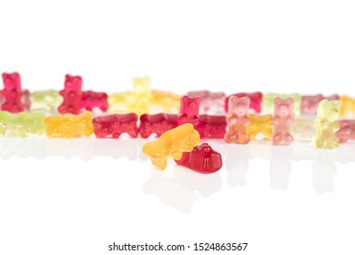 Lot of whole arranged gummy bear in row isolated on white background