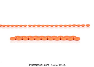 Lot of whole arranged orange tablet pharmacy isolated on white background