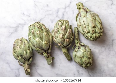 whole artichokes on a light background