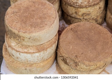 Whole artisan cheese rounds.  Brown rind