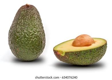Whole avocado plus half seed isolated on white background