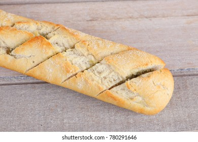 Whole baguette with herb butter