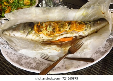 whole baked seabass stuffed with orange, lavender and fennel with zucchini courgette, broad bean, pea and mint salad