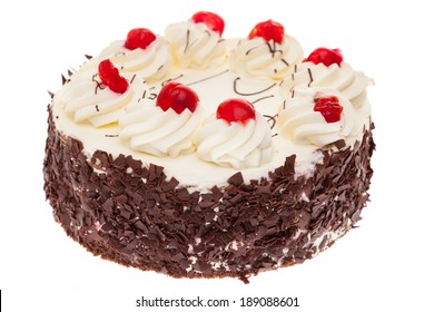 A whole black forest cake isolated on white background