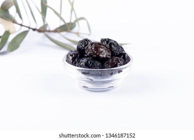 whole black olives isolated on white background