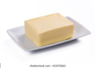 whole block butter on white plate isolated on white background
