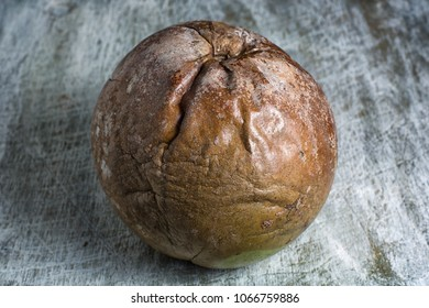 whole borojo fully ripe fruit closeup on wood surface