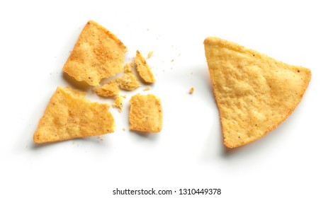 whole and broken corn chips nachos isolated on white background, top view