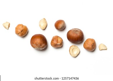 Сomposition of whole and broken hazelnuts and hazelnuts in shell on a white background