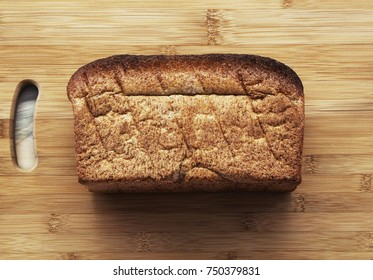Whole brown bread loaf, good, healthy and wholesome, traditional shape, top view.