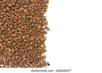 Lot of whole brown clay pebbles (leca) copyspace flatlay isolated on white background