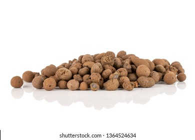 Lot of whole brown clay pebbles (leca) stack isolated on white background
