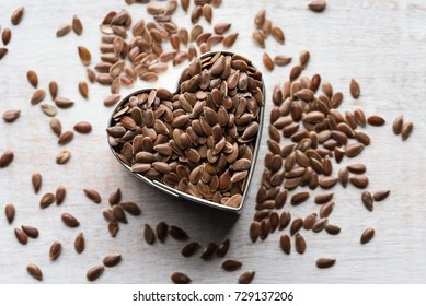 Whole Brown Flaxseeds in a Heart Shape