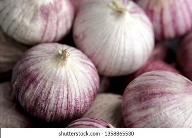 Whole Bulbs of Chinese Garlic in blue bowl
