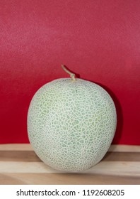 A whole of cantaloupe melon fruits on red background,Green melons or cantaloupe melons plants on red background,Cantaloupe melon,Fresh fruit,Healthy fruit,
