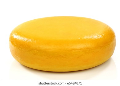 """whole cheese called """"Goudse kaas"""" (Gouda cheese) on a white background"""