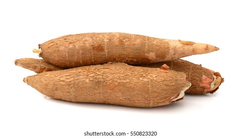 whole and chopped cassava (yucca) isolated on white background