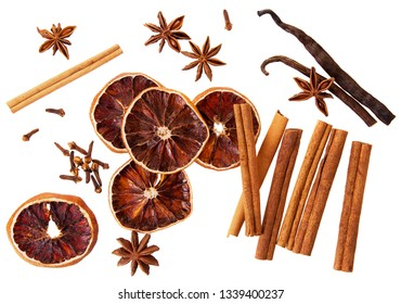 Whole cinnamon isolated. Whole cinnamon sticks, orange circle dry cloves, vanilla pods and spicy cloves isolated on white background