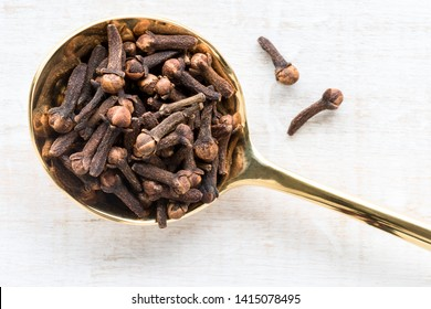 Whole Cloves on a Gold Spoon