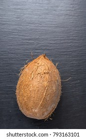 whole coconut on a blue background