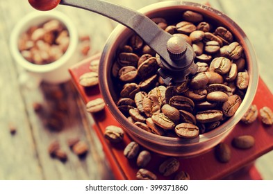 Whole coffee beans in a coffee grinder. Selective focus.
