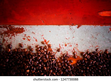 whole coffee beans on an old rustic vintage table