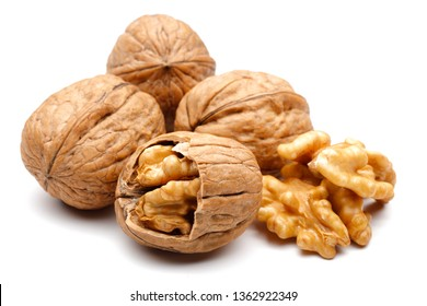 Whole and cracked walnuts isolated on white background
