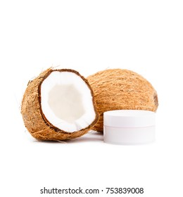 Whole and cut in half coconuts with skin cream isolated on white background