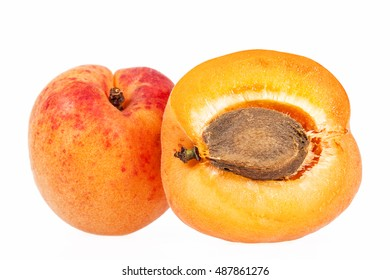 Whole and cut ripe fruits of apricot isolated on white background, close up.