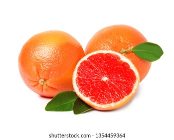 Whole and cut ripe grapefruits isolated on white
